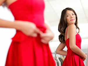 Woman trying on red dress