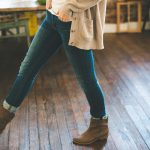 light-fashion-hands-woman-fall-boots-jeans